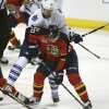 Photo - Toronto Maple Leafs' James van Riemsdyk (21) applies pressure as Florida Panthers' Sean Bergenheim (20) looks for a shot during the first period of an NHL hockey game in Sunrise, Fla., Tuesday, Feb. 4, 2014. (AP Photo/J Pat Carter)