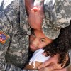 SFC Joe Van Ausdall, Stillwater, OK, hugs Esmei Negron, 7, of Ada, OK, the daughter of a fellow soldier as he says goodbye to his friend\'s family after the 45th Infantry Brigade Combat Team Deployment Ceremony in downtown Oklahoma City, Wednesday, Feb. 16, 2011. This will be Van Ausdall\'s third deployment. Photo by Jim Beckel, The Oklahoman