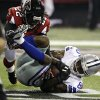 Dallas Cowboys wide receiver Kevin Ogletree (85) makes a catch for a touchdown as Atlanta Falcons cornerback Asante Samuel (22) defends during the second half of an NFL football game, Sunday, Nov. 4, 2012, in Atlanta. (AP Photo/Chuck Burton)