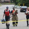 FLASH FLOODS / TORRENTIAL RAIN / FLOOD / FLOODING / DOG RESCUE / THE VALLEY HOUSING ADDITION: Three Oklahoma City firefighters carry dogs rescued from the flooding in The Valley in Edmond, Monday, June 14, 2010. Photo by David McDaniel, The Oklahoman ORG XMIT: KOD