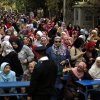 Egyptian women line up outside a polling station to cast their votes during a referendum on a disputed constitution drafted by Islamist supporters of President Morsi in Cairo, Egypt, Saturday, Dec. 15, 2012.(AP Photo/Khalil Hamra) ORG XMIT: KH118