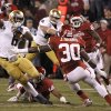 Notre Dame \'s Theo Riddick (6) cuts by OU\'s Javon Harris (30) for a touchdown during the college football game between the University of Oklahoma Sooners (OU) and the Notre Dame Fighting Irish at the Gaylord Family-Oklahoma Memorial Stadium on Saturday, Oct. 27, 2012, in Norman, Okla. Photo by Chris Landsberger, The Oklahoman