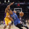 LOS ANGELES LAKERS: Oklahoma City\'s Russell Westbrook (0) drives past Los Angeles\' Ramon Sessions (7) during Game 4 in the second round of the NBA basketball playoffs between the L.A. Lakers and the Oklahoma City Thunder at the Staples Center in Los Angeles, Saturday, May 19, 2012. Photo by Nate Billings, The Oklahoman