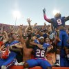 Florida defensive backs Marcus Roberson, left, De\'Ante Saunders (26) and Josh Evans (9) celebrate with fans after defeating LSU 14-6 in an NCAA college football game Saturday, Oct. 6, 2012, in Gainesville, Fla. Florida won 14-6.(AP Photo/John Raoux)