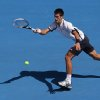 Serbia\'s Novak Djokovic hits a forehand return during his third round match against Radek Stepanek of the Czech Republic at the Australian Open tennis championship in Melbourne, Australia, Friday, Jan. 18, 2013. (AP Photo/Aaron Favila)