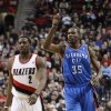 Oklahoma City Thunder\'s Kevin Durant (35) points skyward after scoring over Portland Trail Blazers\' Wesley Matthews (2) in the second quarter of an NBA basketball game, Tuesday, March 27, 2012, in Portland, Ore. (AP Photo/Rick Bowmer)