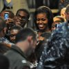 First Lady Michelle Obama greets sailors and their family members at the Mayport Naval Station in Jacksonville, Fla., Wednesday, Aug. 22, 2012. The first lady chose a naval station in the electoral battleground of Florida to announce that 2,000 businesses around the country have hired or trained more than 125,000 military veterans and spouses in the past year, exceeding a White House goal of 100,000 by the end of next year. (AP Photo/The Florida Times-Union, Bob Mack)