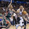 Oklahoma City\'s Russell Westbrook (0) drives past Milwaukee \'s Brandon Jennings (3) during the season finally NBA basketball game between the Oklahoma City Thunder and the Milwaukee Bucks at Chesapeake Energy Arena on Wednesday, April 17, 2013, in Oklahoma City, Okla. Photo by Chris Landsberger, The Oklahoman