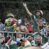 Photo - Mexican fans cheer in a downpour before the group A World Cup soccer match between Mexico and Cameroon in the Arena das Dunas in Natal, Brazil, Friday, June 13, 2014.  (AP Photo/Petr David Josek)
