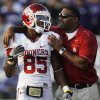 Oklahoma wide receiver Ryan Broyles (85) is congratulated by assistant coach Cory Callens, right, during the second half of an NCAA college football game against Kansas State Saturday, Oct. 29, 2011, in Manhattan, Kan. Broyles caught 14 passes for 171 yards. Oklahoma defeated Kansas State 58-17. (AP Photo/Orlin Wagner) ORG XMIT: KSOW118