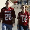 Travis Brewer and Megan McClure of Los Alamos, NM, walk to the stadium before the Brut Sun Bowl college football game between the University of Oklahoma Sooners (OU) and the Stanford University Cardinal on Thursday, Dec. 31, 2009, in El Paso, Tex. Photo by Steve Sisney, The Oklahoman