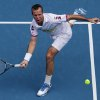 Radek Stepanek of the Czech Republic hits a forehand return to Serbia\'s Novak Djokovic during their third round match at the Australian Open tennis championship in Melbourne, Australia, Friday, Jan. 18, 2013. (AP Photo/Aaron Favila)