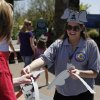 Zoo worker Deanna Dydynski passes out elephant ears to zoo guests during Malee\'s Second Birthday Bash at the Oklahoma City Zoo, Sunday, April 14, 2013. Photo by Garett Fisbeck, For The Oklahoman