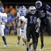 Guthrie\'s Blaze Hastings, left, and L\'Liott Curry celebrate a fumble recovery the high school football game between Guthrie and Deer Creek at Guthrie, Thursday, Oct. 18, 2012. Photo by Sarah Phipps, The Oklahoman