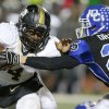 McAlester\'s Jarome Smith fights off Deer Creek\'s Chad Draper during a high school football playoff game at Deer Creek, Friday, Nov. 16, 2012. Photo by Bryan Terry, The Oklahoman