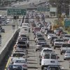 FILE - In this Thursday, May 26, 2011 file photo, a motorcyclist rides between lanes as traffic backs up on US highway 101 before the start of the Memorial Day weekend in Mill Valley, Calif. The United Nations climate chief is urging people not to look solely to their governments to make tough decisions to slow global warming, and instead to consider their own role in solving the problem. Approaching the half-way point of two-week climate talks in Doha, Christiana Figueres, the head of the U.N.\'s climate change secretariat, said Friday, Nov. 30, 2012 that she didn\'t see