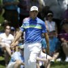 Gary Woodland reacts as he\'s unable to sink a putt for birdie on the second green during the final round of the Byron Nelson Championship golf tournament, Sunday, May 18, 2014, in Irving, Texas. (AP Photo/Tony Gutierrez)