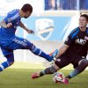 Photo - Montreal Impact's Andres Romero, left, scores against New England Revolution's Bobby Shuttleworth during first half MLS soccer action in Montreal, Saturday, May 31, 2014. (AP Photo/The Canadian Press, Graham Hughes)