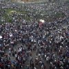 Protesters gather in Tahrir square in Cairo, Egypt, Friday, Oct. 12, 2012. Thousands of supporters and opponents of Egypt\'s new Islamist president clashed in Cairo\'s Tahrir Square on Friday, hurling stones and concrete and swinging sticks at each other in the first such violence since Mohammed Morsi took office more than three months ago.(AP Photo/Khalil Hamra)