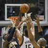 Indiana Pacers\' Roy Hibbert, left, blocks the shot by Milwaukee Bucks\' Tobias Harris (15) during the second half of an NBA basketball game on Wednesday, Nov. 14, 2012, in Milwaukee. (AP Photo/Tom Lynn)