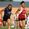 Janelle Wright of Choctaw, left, and Tyler Wisby of Douglass race to finish of the girls 4x100 meter relay during the Oklahoma Meet of Champions track and field event at Moore High School in Moore, Okla., Tuesday, May 18, 2010. Choctaw finished first with Douglass in second. Photo by Nate Billings, The Oklahoman
