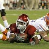 OU\'s Chris Brown comes up short on a fourth down as Florida\'s Joe Haden brings him down during the first half of the BCS National Championship college football game between the University of Oklahoma Sooners (OU) and the University of Florida Gators (UF) on Thursday, Jan. 8, 2009, at Dolphin Stadium in Miami Gardens, Fla. PHOTO BY BRYAN TERRY, THE OKLAHOMAN