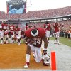 OU\'s Brennan Clay (24) kneels in prayer during the Red River Rivalry college football game between the University of Oklahoma (OU) and the University of Texas (UT) at the Cotton Bowl in Dallas, Saturday, Oct. 13, 2012. Photo by Chris Landsberger, The Oklahoman