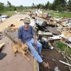 Charles Taylor, 37, sits with his dog, Sissy, Wednesday afternoon, May 12, 2010, on the hearth in what was his living room before a tornado destroyed his mobile home near Earlsboro in Pottawatomie County, Monday night. Taylor was not inside his home when the twister hit; he was in his truck headed to his house when he decided he needed to turn around to find shelter, but not before he found himself trapped in his truck as the tornado went past. He was not injured. He came home to find all that remains of his home is the foundation. Photo by Jim Beckel, The Oklahoman