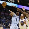 Memphis Grizzlies\' Mike Conley (11) shoots against Golden State Warriors\' David Lee (10) during the first half of an NBA basketball game, Wednesday, Jan. 9, 2013, in Oakland, Calif. (AP Photo/Ben Margot)