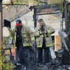 Photo -  Oklahoma City firefighters investigate a fatal house fire Tuesday at 1310 SW 23 in Oklahoma City. An explosion caused the fire, which killed a 6-year-old boy. Photo by Paul B. Southerland, The Oklahoman   PAUL B. SOUTHERLAND -