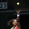 Photo -   Serena Williams of the US prepares to serve to Na Li of China, during their tennis match on the second day of the WTA championship in Istanbul, Turkey, Wednesday, Oct. 24, 2012. (AP Photo)