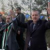 In this photo provided by Turkish Prime Minister\'s Press Service, Turkish Prime Minister Recep Tayyip Erdogan, right, flanked by the Syrian opposition coalition leader Mouaz al-Khatib, waves to people as he addresses residents of a Turkish village near the Syrian border, in Sanliurfa, Turkey, Sunday, Dec. 30, 2012. Erdogan repeated a call on Syrian President Bashar Assad to step down. (AP Photo/Kayhan Ozer)
