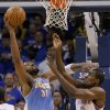 Oklahoma City\'s Serge Ibaka (9) battles with Denver\'s Nene (31) under the basket during the first round NBA playoff game between the Oklahoma City Thunder and the Denver Nuggets on Sunday, April 17, 2011, in Oklahoma City, Okla. Photo by Chris Landsberger, The Oklahoman