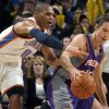 Oklahoma City\'s Russell Westbrook (0) pressures Phoenix\'s Steve Nash (13)during the NBA basketball game between the Oklahoma City Thunder and the Phoenix Suns, Sunday, Dec. 19, 2010, at the Oklahoma City Arena. Photo by Sarah Phipps, The Oklahoman