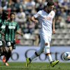 Photo - Roma's Mattia Destro, right, scores against Sassuolo during their Serie A soccer match at Reggio Emilia's Mapei stadium, Italy, Sunday, March 30, 2014. (AP Photo/Marco Vasini)