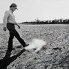 Arthur Rickets is shown kicking up dirt as he walks through a dry peanut field after the 1980 drought. STAFF PHOTO BY J. DON COOK, THE OKLAHOMAN