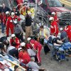 Injured spectators are treated after a crash at the conclusion of the NASCAR Nationwide Series auto race Saturday, Feb. 23, 2013, at Daytona International Speedway in Daytona Beach, Fla. Driver Kyle Larson\'s car hit the safety fence sending car parts and other debris flying into the stands. (AP Photo/David Graham)