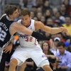 San Antonio Spurs center Tiago Splitter, left, of Brazil, knocks the ball from the hands of Los Angeles Clippers forward Blake Griffin during the first half of an NBA basketball game, Thursday, Feb. 21, 2013, in Los Angeles. (AP Photo/Mark J. Terrill)