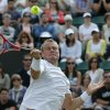 Photo - Lleyton Hewitt of Australia plays a return to Jerzy Janowicz of Poland during their men's singles match at the All England Lawn Tennis Championships in Wimbledon, London, Friday, June 27, 2014. (AP Photo/Ben Curtis)