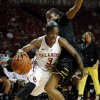 Oklahoma\'s Aaryn Ellenberg drives past Alex Harden as the University of Oklahoma Sooners (OU) play the Wichita State Shockers in NCAA, women\'s college basketball at The Lloyd Noble Center on Sunday, Nov. 10, 2013 in Norman, Okla. Photo by Steve Sisney, The Oklahoman