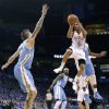 Oklahoma City\'s Eric Maynor (6) drives to the basket against Denver\'s Chris Andersen (11) during the first round NBA playoff game between the Oklahoma City Thunder and the Denver Nuggets on Sunday, April 17, 2011, in Oklahoma City, Okla. Photo by Chris Landsberger, The Oklahoman