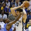 Oklahoma City\'s Serge Ibaka (9) defends Memphis\' Marc Gasol (33) during Game 6 in the first round of the NBA playoffs between the Oklahoma City Thunder and the Memphis Grizzlies at FedExForum in Memphis, Tenn., Thursday, May 1, 2014. Photo by Bryan Terry, The Oklahoman