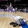Robert Wakefield of Midwest City falls to the ground as Tulsa Memorial celebrates their win the class 6A boys state basketball semifinal at the Ford Center in Oklahoma City, Friday March 7, 2008. BY BRYAN TERRY, THE OKLAHOMAN
