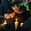 Ted Kowalczuk, of Milford, Conn., and his friend Rachel Schiavone, of Norwalk, Conn., attend a candlelight vigil held behind Stratford High School on the Town Hall Green in Stratford, Conn. on Saturday December 15, 2012. Kowalczuk and Schiavone were close friends to Stratford High graduate Vicki Soto, who was killed in yesterday\'s mass shooting at Sandy Hook Elementary School in Newtown. Soto was a teacher at the school.(AP Photo/The Connecticut Post, Christian Abraham) MANDATORY CREDIT