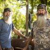 "Photo - This undated image released by A&E shows brothers Silas ""Uncle Si"" Robertson, left, and Phil Robertson from the popular series ""Duck Dynasty."" Phil Robertson was suspended last week for disparaging comments he made to GQ magazine about gay people. (AP Photo/A&E, Zach Dilgard)"