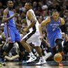 Oklahoma City\'s Russell Westbrook (0) goes for the ball in front of Kevin Durant (35) and San Antonio\'s Boris Diaw (33) during Game 2 of the Western Conference Finals in the NBA playoffs between the Oklahoma City Thunder and the San Antonio Spurs at the AT&T Center in San Antonio, Wednesday, May 21, 2014. Photo by Sarah Phipps, The Oklahoman