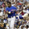 Photo - FILE - In this June 18, 2004, file photo, Chicago Cubs' Sammy Sosa tosses his helmet and shin guard after striking out to end the sixth inning against the Oakland Athletics during a baseball game in Chicago. With the cloud of steroids shrouding many candidacies, baseball writers may fail for the only the second time in more than four decades to elect anyone to the Hall. (AP Photo/Nam Y. Huh, File)