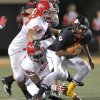 Carl Albert\'s Robert Lolofie (68) and Chantz Woodberry (80) sack East Central\'s Trevaughn Cherry (9) during the Class 5A Oklahoma state championship football game between Carl Albert High School and Tulsa East Central High School at Boone Pickens Stadium on Saturday, Dec. 1, 2012, in Stillwater, Okla. Photo by Chris Landsberger, The Oklahoman
