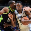 Photo -   Memphis Grizzlies forward Rudy Gay, right, drives to the basket defended by Real Madrid forward Marcus Anthony Slaughter, left, in the first half of an NBA basketball preseason game on Saturday, Oct. 6, 2012, in Memphis, Tenn. (AP Photo/Nikki Boertman)