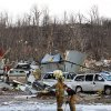 Fireman go through debris of businesses and homes along U.S. 31 in Henryville, Ind., after powerful storms stretching from the U.S. Gulf Coast to the Great Lakes in the north wrecked two small towns and killed at least eight people Friday, March 2, 2012, as the system tore roofs off schools and homes and damaged a maximum security prison. It was the second deadly tornado outbreak this week. (AP Photo/The News and Tribune, C.E. Branham) ORG XMIT: INJEF107
